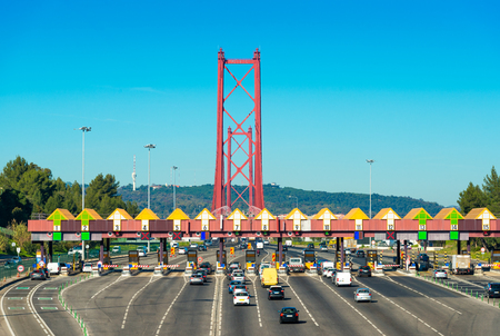 Toll station at the entrance to the 25th April Bridge between Lisbon and Almada, Portugal. Cars passing through pay station 版權商用圖片