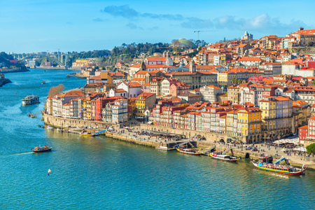 Cityscape of Porto (Oporto) old town, Portugal. Valley of the Douro River. Panorama of the famous Portuguese city. Popular tourist destination