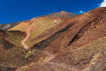 Beautiful valley between giant red-brown lava hills. Mount Etna, Sicily, Italy