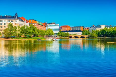 Cityscape of Helsinki mirrored in water, Finland Stockfoto
