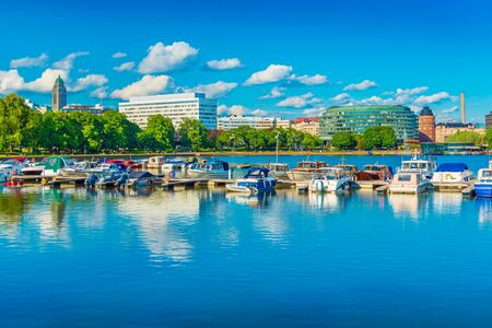 Helsinki skyline, cityscape with old and modern architecture, park, and a lake with boats, Finland Stockfoto