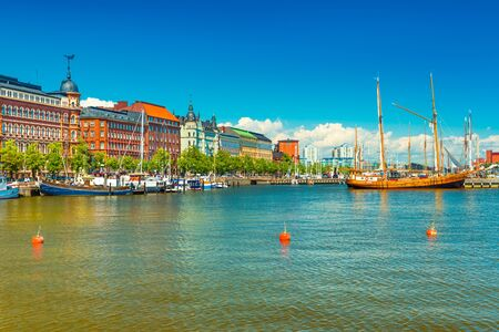 Beautiful cityscape of Helsinki, Finland. Old historical buildings, wooden ship, blue sky with clouds