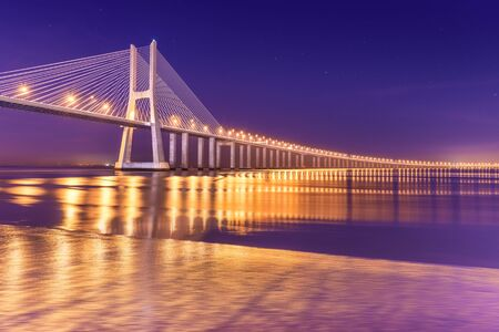 View of a modern cable-stayed bridge at night (Vasco da Gama Bridge), Lisbon, Portugal