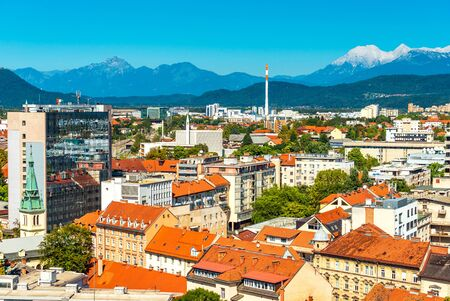 Beautiful cityscape of Ljubljana, panoramic view of the European city with mountains Alps in the background, Slovenia Imagens