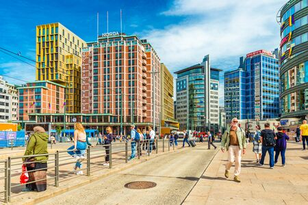 Oslo - June 2019, Norway: View of downtown Oslo with modern buildings and walking people. Colorful architecture in the capital of Norway