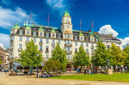 Oslo - June 2019, Norway: View of the Grand Hotel Oslo building with blue sky in the background