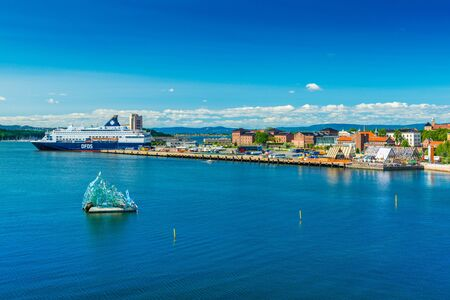Oslo - June 2019, Norway: Beautiful aerial cityscape of the capital of Norway. Skyline with a cruise ship, modern sculpture and historical architecture Sajtókép