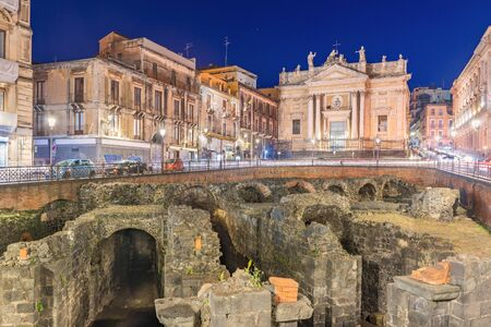 Catania - April 2019, Sicily, Italy: Night view of the Roman Amphitheater of Catania, ruins of an ancient theater in the famous Sicilian city Sajtókép