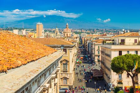 Catania - April 2019, Sicily, Italy: Panoramic view of the famous Sicilian city with The Mount Etna in the background. View of the central street Via Etnea