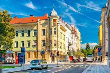 Ljubljana - September 2019, Slovenia: A street in the historical city center of Ljubljana. Old colorful buildings with blue sky in the background