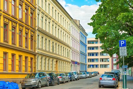 Oslo - June 2019, Norway: A street of Oslo with colorful historical architecture and cars parked along the street