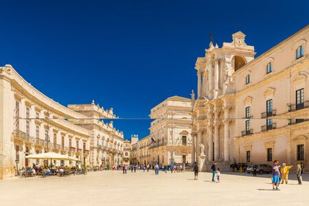 Ortygia - April 2019, Syracuse, Italy: View of The Cathedral of Syracuse and the central square (Piazza Duomo)