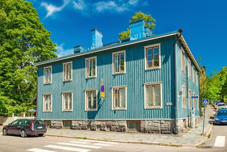 Helsinki - June 2019, Finland: Old wooden residential house on one of the streets in neighborhood Helsinki
