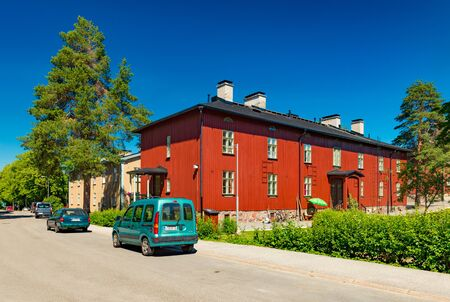 Helsinki - June 2019, Finland: Red wooden house in the traditional finnish architectural style Sajtókép