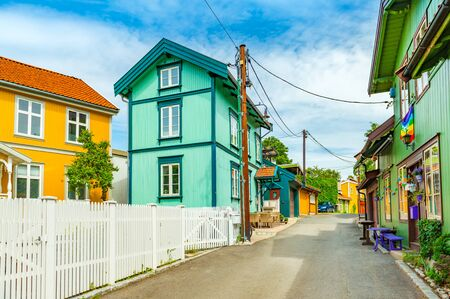 Oslo - June 2019, Norway: Colorful wooden houses on a street of Oslo