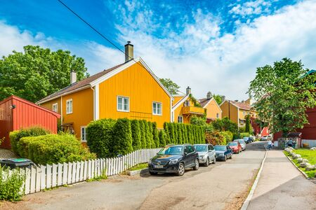 Oslo - June 2019, Norway: A typical street of Oslo with colorful wooden houses in the traditional architectural style
