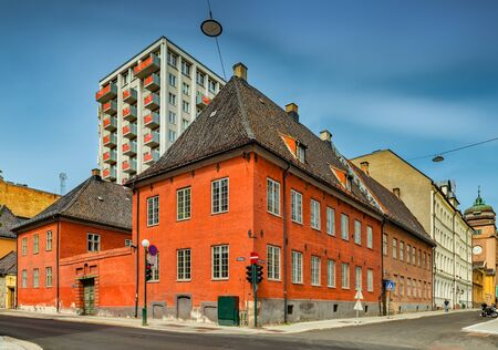 Oslo - June 2019, Norway: View of the  former City hall building in the central Oslo. Historical building with a stormy sky in the background