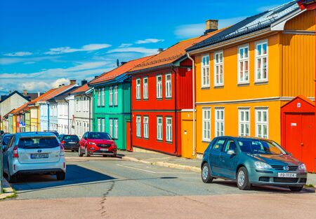 Oslo - June 2019, Norway: Colorful wooden houses on a street of Oslo. Traditional Norwegian architecture Sajtókép