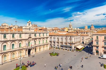 Catania - April 2019, Italy: Cityscape of Catania in the morning. People walking on the main square in the historical city center Sajtókép