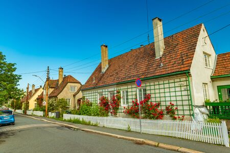 Oslo - June 2019, Norway: View of street on one of the hills around the city of Oslo. Row of houses in the traditional architectural style Sajtókép