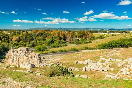 Syracuse - April 2019, Italy: Beautiful landscape panorama viewed from the Archaeological Park of Syracuse. Ruins of an ancient stone construction