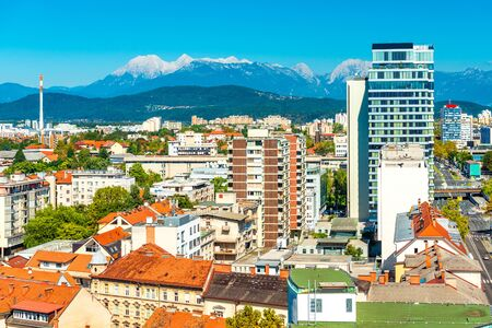 Panorama of Ljubljana with modern architecture and the beautiful Alps on the background