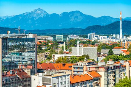 Aerial panorama of Ljubljana with modern buildings and the Alps in the background, Slovenia
