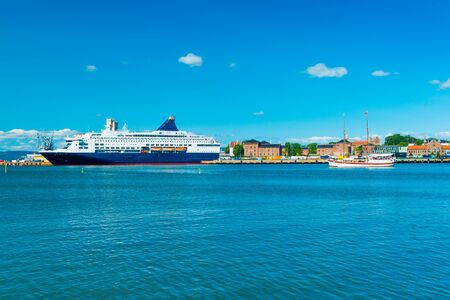 View of the harbor of Oslo with a cruise ship and historical, wooden, sailing ship, Norway Stock fotó