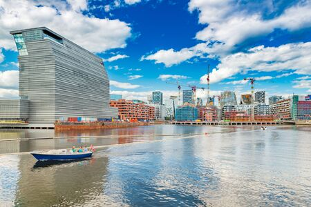 Cityscape of downtown Oslo with modern architecture, boat with a group of people and the blue sky with clouds, Norway Stock fotó