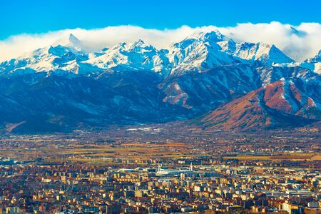 Cityscape of Turin with picturesque snowy Alps high rising on the background, Italy Stock fotó
