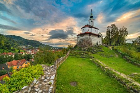 An old church on the hill with a dramatic sky in the background Stock fotó