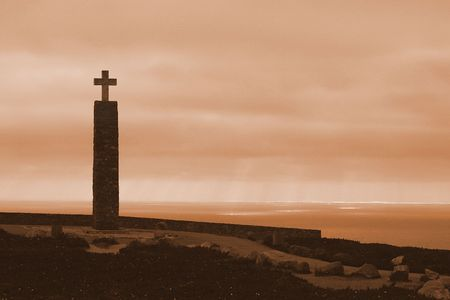 Monument with cross on the edge of the Sea