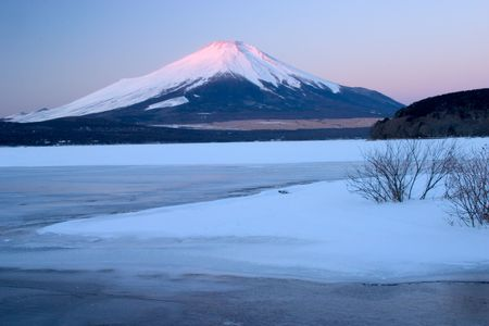 Mount Fuji with a frozen Lake Yamanaka in foreground