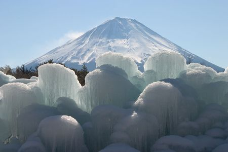 Icicle formations with Mount Fuji in background Stock Photo - 503569