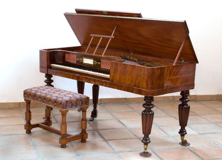 upright: An antique square piano manufactured in London in 1833