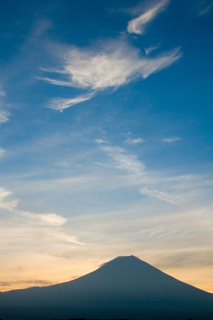 Early morning view of Mount Fuji with cloud formations in the shape of a Pterodactyl