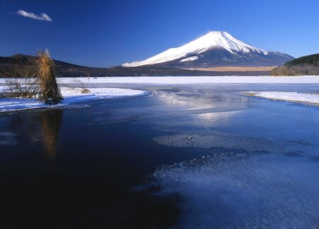Scenic view of Mount Fuji in Winter with a frozen lake in the foreground Stock Photo - 540417
