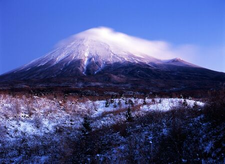 Misty clouds on the the snowcapped peak of Mount Fuji Stock Photo - 540416