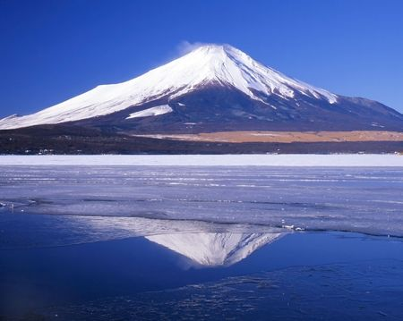 Mount Fuji and her reflections in a break in the ice.