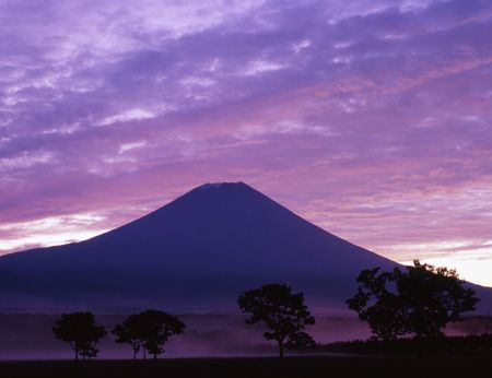 Mount Fuji in the dawn with purple mist and clouds Stock Photo - 579639