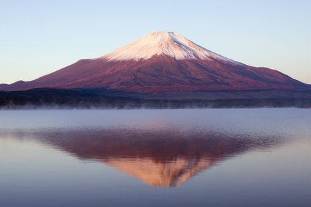 Reflections of Mount Fuji in the misty surface of a lake