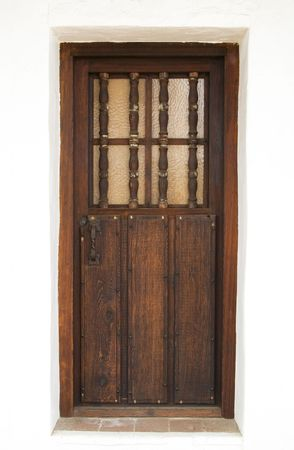 An old and decorative wooden door from an historical building in California