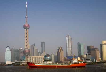 View of Shanghai with the Oriental Pearl Tower and a red ship in the foreground