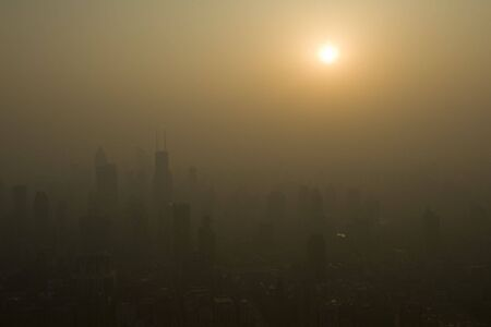 Sunset over the smoggy skies of Shanghai Stock Photo