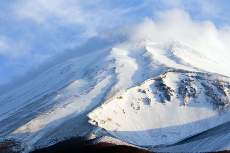 A dramatic close-up of snow covered Mount Fuji Stock Photo - 948360