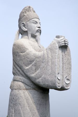 An old Chinese statue near a temple in the countryside  Stock Photo