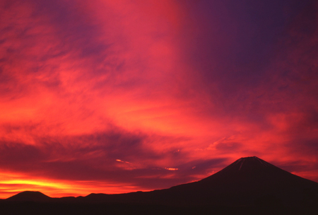 Blood red sunrise over the silhouette of Mt. Fuji