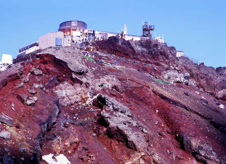 View of the human and natural damage of rim of Mount Fujis crater