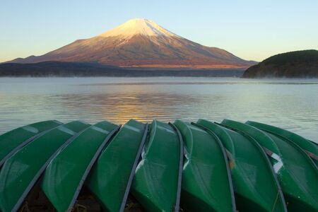 Green rowboats on the lakeshore with Mount Fuji Stock Photo - 2084660