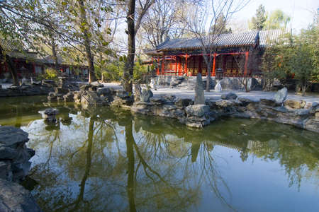 An ancient Chinese garden with pond in Beijing photo